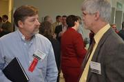 Jeno Cossette with D.H. Griffin Construction, left, has a conversation with David Wells.