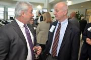 Ed Weems, right, and Tim McGuiness chat before the Power Breakfast interview with RDU's Michael Landguth.