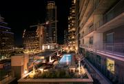 Poolside at the Whitley at night provides dramatic skyline viewing.