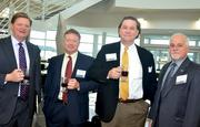Al Farnell, Monty Irvin, Michael Cole and Jim Smith enjoy a cup of coffee during TBJ's Power Breakfast at RDU's General Aviation terminal.
