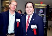 Josh Point and Michael Thomas with McConnell Golf were one of the sponsors for TBJ's Power Breakfast at RDU's General Aviation terminal.