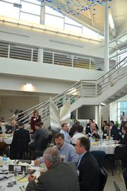 Attendees at TBJ's Power Breakfast enjoy a breakfast of bacon, eggs, biscuits and grits.
