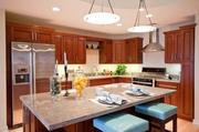Stainless steel appliance and rich wood cabinets create a cozy kitchen setting for dining and casual entertaining.