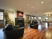 The spacious penthouse at The Towers at Town Lake feature hardwood floors, specialty lighting and gorgeous artwork.