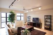 The living room at the Park West Residences is a calm sanctuary about the city beat.