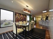 What will dinner guests enjoy more — the views or the colorful artwork at the penthouse at The Towers at Town Lake?