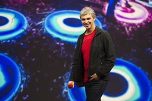 Larry Page, co-founder and chief executive officer at Google Inc., smiles while speaking at the Google I/O Annual Developers Conference in San Francisco, California, on Wednesday, May 15, 2013.
