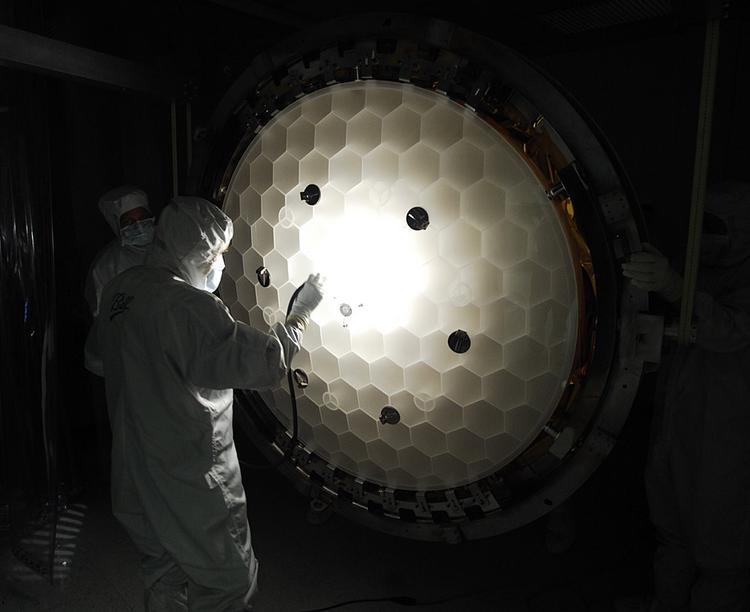 A Ball Aerospace worker inspects a part the company built for NASA's Kepler space telescope.