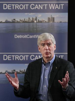 Michigan Gov. Rick Snyder speaks at a public meeting in Detroit on Friday. Snyder said he plans to name an emergency manager to handle Detroit's fiscal crisis, stripping power from local officials in a withered city that in 1940 was the fourth biggest in the U.S. and a thriving capital of industry.
