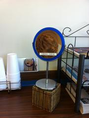 The tabouli check mirror is conveniently located near the door at the Whiteway Deli, allowing customers to make sure their teeth are free of food.