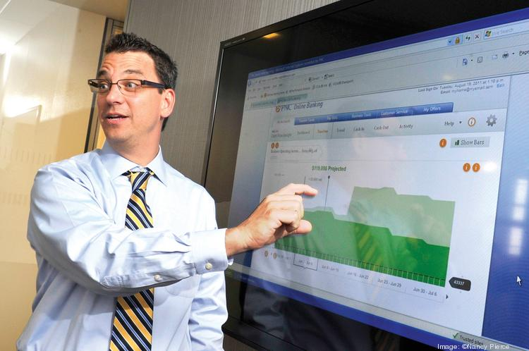 Conrad Wood at PNC Financial shows off  the bank's new Cash Flow Insights program that was created for small-business customers.