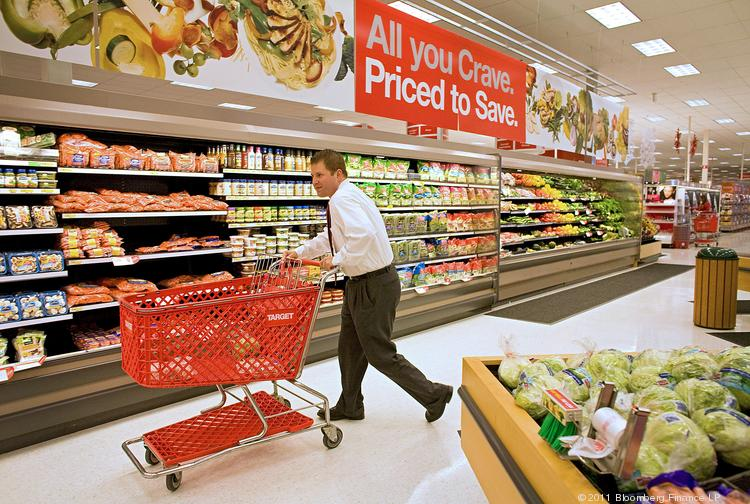 A customer shops for produce at a Super Target store in Denver.