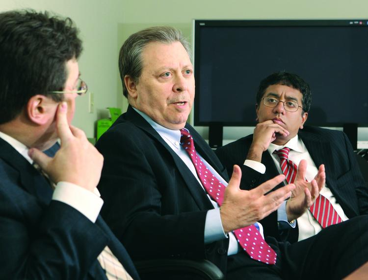 William Stang, center, Pittsburgh managing partner of Fox Rothschild LLP, speaks during a roundtable discussion April 15 at the Pittsburgh Business Times offices as Spilman Thomas & Battle PLLC's Ron Schuler, left, and Gordon & Rees LLP's Manoj Jegasothy listen.