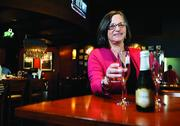 """Lee Goodfriend, co-owner of Racine's, offers couples who have had a civil union a free small bottle of champagne with their meal. She says, """"We wanted to celebrate something that is really important in Colorado — to make sure gay people have same the rights as the rest of us. They almost do now."""""""