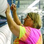 Unifi opens $28M N.C. bottle processing center, adds 87 jobs