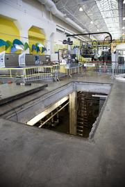OMSI's Turbine Hall features removable floor plates, shown here as OMSI prepares to install two new energy-efficient chillers – the 550-ton centrifugal chiller with magnetic bearings and the 150-ton heat recovery scroll compressor chiller. The old equipment had previously been uninstalled through the same opening, to make room for the largest capacity chiller of this type in the Northwest to be installed. New chillers will help to keep the nearly one million visitors to the museum each year cool and comfortable while OMSI realizes an estimated $90,000 in annual energy cost savings.