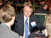 Joseph Slater of Wright State University talks to other guests at the 2013 Spring Defense Forum.