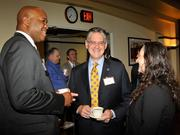 Maurice McDonald (left), of the Dayton Development Coalition, speaks with Dan Marion of Deloitte and other guests at the 2013 Spring Defense Forum.