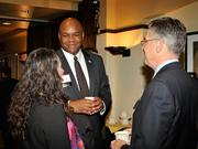 Maurice McDonald (cente), of the Dayton Development Coalition, speaks with Dan Marion of Deloitte and other guests at the 2013 Spring Defense Forum.