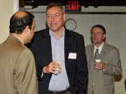 Scott Sullivan of SelectTech Services Corp. talks with other guests at the 2013 Spring Defense Forum.