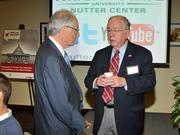 Former Congressman Dave Hobson (right) speaks with David Hopkins, president of Wright State University, at the 2013 Spring Defense Forum.