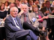 David Hopkins, president of Wright State University, and other guests listen to the speakers at the 2013 Spring Defense Forum.
