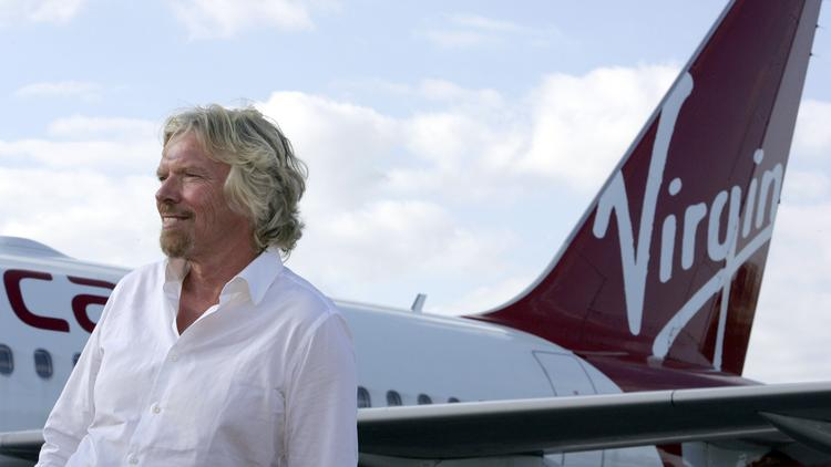 Richard Branson, founder and chairman of Virgin Group Ltd., and his airline are bringing more flights to Orlando.