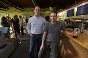 Jerry Nevins (left) and Andy Talbert are two of the four co-owners of Snow & Co. bar in the Crossroads Arts District.
