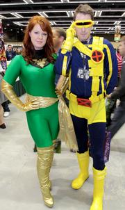 Tabitha Englebright, 25, as Phoenix from the X-Men, and Andrew Squires, 24, as Cyclops from the X-Men, at the three-day Emerald City Comicon at the Washington State Convention Center in Seattle.