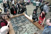 Geek Chic, of Everett, shows off high-end gaming tables at the three-day Emerald City Comicon at the Washington State Convention Center.