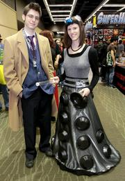 Kyle Grossie, 25, as Doctor Who and Sara Grossie, 23, one of the Doctor's arch enemies, a Dalek, at the three-day Emerald City Comicon at the Washington State Convention Center in Seattle.