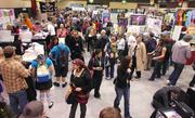 Minutes after the doors opened at the three-day Emerald City Comicon at the Washington State Convention Center in Seattle. the show floor was filled with fans.