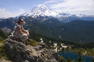 A hiker near Mount Rainier. In Washington state, companies providing clothing and equipment for outdoor recreation produce $22 billion in revenue and account for approximately 200,000 jobs per year.
