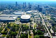 """But two churches, boxed out in this photo, must sell their land if the new stadium is to be on the preferred """"South site."""""""