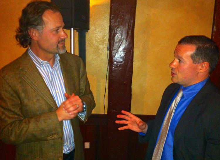 Brian D. Singer, left, of William Blair & Co. LLC chats with Tom Tzitzouris, of Strategas Research Partners LLC.
