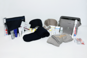 The current international first class (right) and business class amenity kits from British Airways feature Elemis amenities. Earlier BA bags helped popularize Molton Brown products.