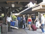 Departing passengers check their bags at Kona International Airport. Despite their names, neither airport has U.S. Customs operations. State officials are trying to restore international service to Kona from Asia.