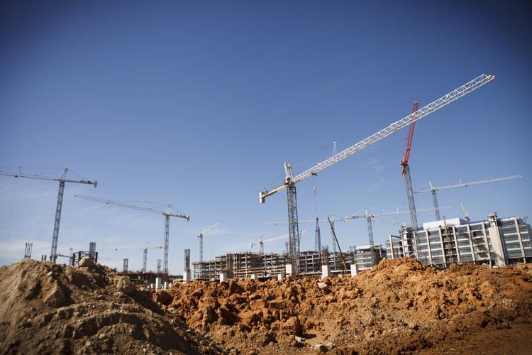 Exxon Mobil is continuing to work on completing its 385-acre corporate campus in Springwoods Village.  Click here to see a sneak peek slideshow of the campus construction.