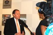 Winston Kelley, executive director of the NASCAR Hall of Fame, talks about the film exhibit with a local news station.