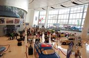 """CBJ Seen: Editorial Assistant Alison Angel attended the May 16 opening of the """"Lights. Camera. NASCAR."""" exhibit at the NASCAR Hall of Fame. The exhibit showcases the role of the sport in showbiz over the years."""