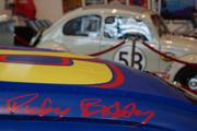 Talladega Nights character Ricky Bobby's Wonder Bread car flanks the Herbie Volkswagon Beetle from the 2005 film Herbie Fully Loaded.