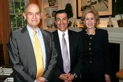 """From left, William Nitze, chairman of Oceana Energy; Vali Nasr, author of """"The Dispensable Nation"""" and dean of the Paul H. Nitze School of Advanced International Studies at Johns Hopkins University; and Ann Nitze, a private art dealer, attend a book party at the Nitze residence in D.C. on May 13. The party was in celebration of Nasr's new book."""
