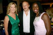 From left, Chris Evert, tennis champion and advocate; Mark Ein, owner of Washington Kastles; and Rynthia Rost, vice president of public affairs at Geico, attend a dinner at the residence of the Swedish ambassador in D.C. on May 15. The event was in Evert's honor.