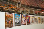 Movie posters surround the exhibit, all films that featured the racing culture of NASCAR in some way.