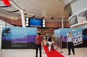 Guests walk the red carpet as they enter the newest exhibit.