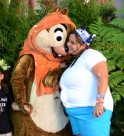 Ewok Chip gets a hug from a fan in a less detailed yet still fashionable costume.