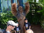 Go ahead Chewbacca, make yourself look even taller next to the little children.