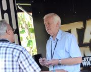 The man who played Boba Fett in the original Star Wars trilogy, Jeremy Bulloch, meets a fan at his autograph table.