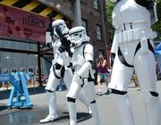 Eight-year-old Danny Hand helps out the park security team. Hand, a member of the Galactic Academy children's costume club, made his own Trooper armor. Maybe with some help from his parents.