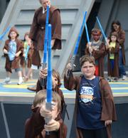 Jedi trainees get some lessons during Star Wars Weekends at Disney's Hollywood Studios. Disney and Lucasfilm Ltd. enjoyed a profitable relationship even before the buyout.